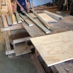 Greg inspects some of the available lumber